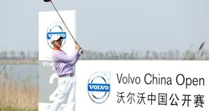 12-year-old Ye Wo-cheng of China tees off during the first day of the Volvo China Open at Binhai Lake Golf Course  in Tianjin, China. Photograph: Lintao Zhang/Getty Images