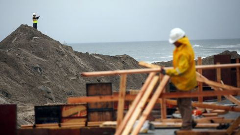 A man surveys the Rockaway boardwalk, which was heavily damaged in Hurricane Sandy. Photograph: Spencer Platt/Getty Images