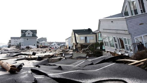 Streets damaged during Hurricane Sandy in Ortley Beach, New Jersey. Superstorm Sandy shifted the sands of the New Jersey shore's summer rental landscape, where some resort towns are suffering lasting effects of the barrage and others are, as they say, cleaning up.  Photograph: Tim Larsen/Governor's Office/Reuters