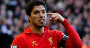 Liverpool captain Steven Gerrard believes Luis Suarez will stay at the club once his ban is completed. Photograph: Phil Noble/Reuters