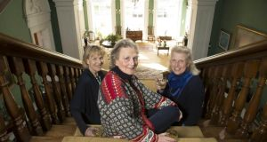 The Jameson sisters on the staircase at Tourin House. Photograph: Patrick Browne