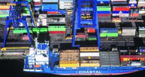 Goods out: a container ship loading in Dublin Port. Photograph: Jason Hawkes/Stone/Getty