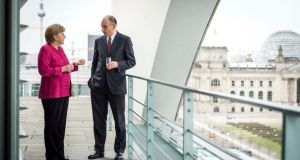 German chancellor Angela Merkel and Italian prime minister Enrico Letta on a balcony at the Chancellery in Berlin earlier this week. Photograph: Jesco Denzel/Reuters