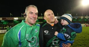 Connacht's head coach Eric Elwood after the match with Johnny O'Connor and his son Jack. Photograph: Inpho