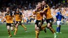 Paul McShane is congratulated by his Hull City and Republic of Ireland team-mate David Meyler after scoring  against Cardiff City at the at KC Stadium. Photograph: Gareth Copley/Getty Images