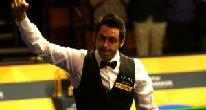 Ronnie O'Sullivan  celebrates beating Judd Trump in the semi-finals  of the Betfair World  Championship at the Crucible Theatre  in Sheffield. Photograph: Warren Little/Getty Images