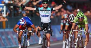 Mark Cavendish  of Omega Pharma-Quick-Step celebrates as he crosses the finish line to win stage one of the  Giro d'Italia in  Naples. Photograph: Bryn Lennon/Getty Images