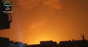 The sky is lit up after an explosion at what Syrian state television reported was a military research centre in Damascus, in this still image taken from video obtained from a social media website by Reuters.