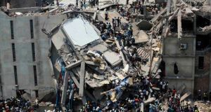 Workers were trapped under rubble at the Rana Plaza building after it collapsed. Photograph: Andrew Biraj/Reuters