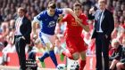 Seamus Coleman of Everton battles for the ball with Jordan Henderson of Liverpool at Anfield. Photograph: Laurence Griffiths/Getty Images