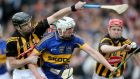 Kilkenny's JJ Delaney and Tommy Walsh (right) challenge Patrick Maher of Tipperary (centre) at Nowlan Park. Photograph: Ryan Byrne/Inpho