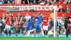 Chelsea's Juan Mata celebrates scoring the winnier. Photograph: Martin  Rickett/PA Wire