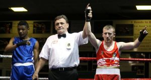 Paddy Barnes are is raised followin his victory over Samuel Kistohurry at the National Stadium.