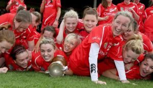 Cork players celebrate with the National League trophy after their victory over Wexford at Nowlan Park.  Photograph: Ryan Byrne/Inpho