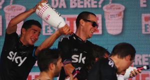 Bradley Wiggins and SKY Procycling celebrates with his team after they won stage two of the Giro d'Italia 2013, a Team Time Trial from Ischia to Forio, on Sunday. Photograph: Getty Images