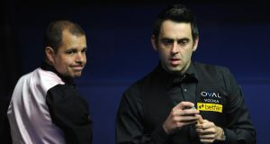 Ronnie O'Sullivan  and Barry Hawkins in their final match during the Betfair World Championships at the Crucible, Sheffield.