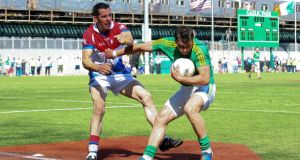 Leitrim's Paul Brennan is tackled by New York's Jason Kelly at the Gaelic Ground. Photo: Ed Mulholland/Inpho
