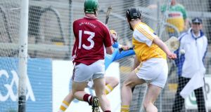 Westmeath's Niall O'Brien scores a goal past Ryan McGarry of Antrim. Photograph: Inpho