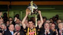 Colin Fennelly lifts the cup after his side's National League final victory over Tipperay. Photograph: Inpho