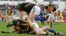 Kilkenny's JJ Delaney and Lar Corbett of Tipperary get involved off the ball  as goalkeeper Eoin Murphy attempts to intervene. Photograph: Inpho