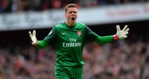 Wojciech Szczesny is confident  Arsenal will secure Champions League football.  Photograph: Shaun Botterill/Getty Images