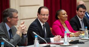 French president President François Hollande with education minister Vincent Peillon (left),  justice minister Christiane Taubira (right) and interior minister Manuel Valls (far right) at a special ministers meeting at the Élysée Palace in Paris