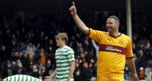 Motherwell's Michael Higdon: arrested over an alleged assault hours after being crowned Scotland Player of the Year.