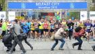 Photographers scramble to get out of the runners' way at the start of the Belfast Marathon. Photograph:  Alan Lewis/PhotopressBelfast.co.uk