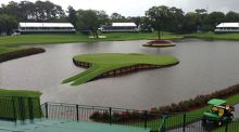The famed 17th green at Sawgrass in Ponte Vedra Beach, Florida, which was left under water after 10 inces of rain fell last week. Photograph: Mike Ehrmann/Getty Images