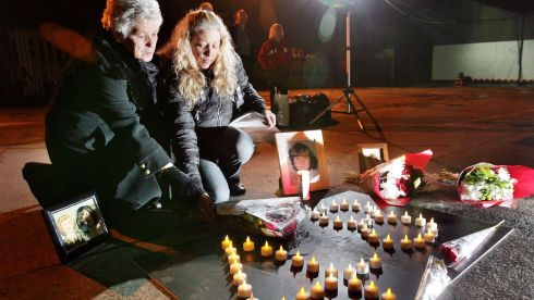 Relatives are demanding the publication of Paul Coffey SC's initial report of his independent examination and also of a Garda report written following an examination of evidence they submitted to the Department of Justice in 2004. Photographed are Christine Keegan left, who lost two daughters Mary 19 and Martha 16 in the Stardust fire placing flowers at the site with her daughter Antionette during a vigil and prayer service to mark the 28th anniversary of the Stardust disaster in Artane on Friday 13th February 2009.