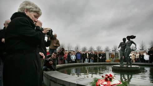 Christine Keegan , who lost two daughters Martina and Mary, in the Stardust fire , wipes tears from her eyes after laying a wreath at the Stardust Memorial, in Coolock,  after a mass to commemorate the 25 Anniversary of the tragedy. Photograph: Alan Betson/The Irish Times