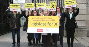 A group of trade union activists in a protest outside the Dáil last month calling  on the Government to legislate for the X case. Photograph: Julien Behal/PA