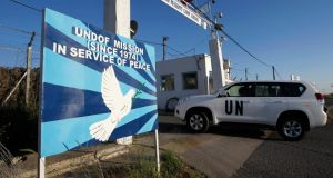 A United Nations armoured car drives through a gate at a UN base near the Kuneitra border crossing between Israel and Syria, in the Israeli-occupied Golan Heights yesterday. Syrian rebels said they were holding a group of Filipino UN peacekeepers on the ceasefire line between Syria and the Israeli-occupied Golan Heights after clashes in the area had put them in danger. Photograph: Reuters/Baz Ratner