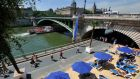 Paris Plage, the artificial beach provided in central Paris in summertime. Photograph: Reuters/Philippe Wojazer