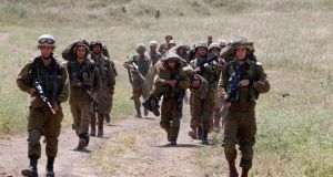 Israeli soldiers walk together during training close to the ceasefire line between Israel and Syria on the Israeli occupied Golan Heights. Photograph: Reuters/Baz Ratner