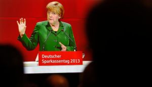 German chancellor Angela Merkel on a video screen as she addresses the audience at a meeting in Dresden recently. Photograph: Fabrizio Bensch/Reuters