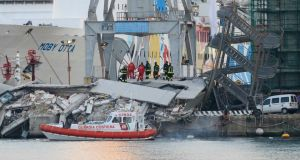 Rescuers continued their search through the debris this morning for seven missing people. At least three people were killed and six injured when a container ship rammed a control tower in the northern Italian port city of Genoa. The huge control tower, which reports said was more than 50 metres (160 feet) high, was destroyed by the impact. Photograph: Alessandro Garofalo/Reuters