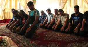 Free Syrian Army fighters perform their prayers in Khirbet Ghazaleh, Daraa, last week. Photograph: Thaer Abdallah/Reuters