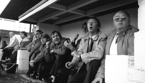 Ferguson (second right) watches his new team for the first time as they crash to a 2-0 defeat. Photograph: PA