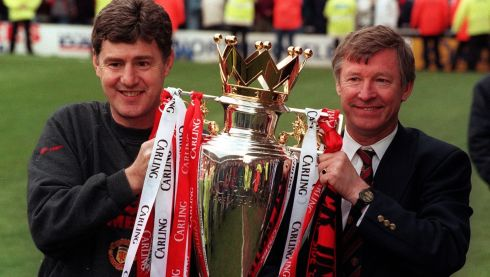 With assistant manager Brian Kidd in 1996, holding the premiership trophy after their side beat Middlesbrough to win the title. Photograph: John Giles/PA Wire