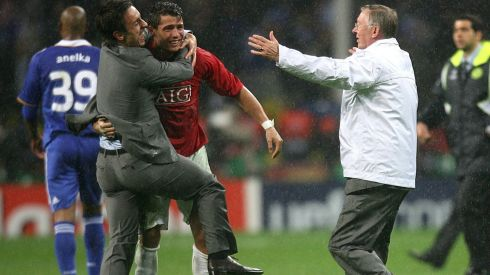 Ferguson runs onto the pitch in May 2008 to congratulate Cristiano Ronaldo with Gary Neville (left). Photograph: Martin Rickett/PA Wire