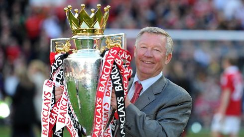 Sir Alex Ferguson in May 2011 celebrates with the Premier League trophy. Photograph: Martin Rickett/PA Wire.