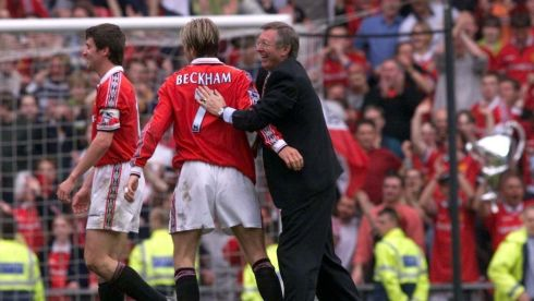 Ferguson (right) congratulates David Beckham (centre) and Roy Keane after his side clinched the Premiership Title in 1999 at Old Trafford. Photograph: Phil Noble/PA Wire