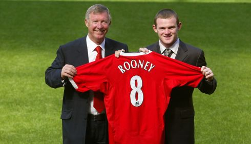With new signing Wayne Rooney in 2004. Photograph: Gareth Copley/PA Wire.