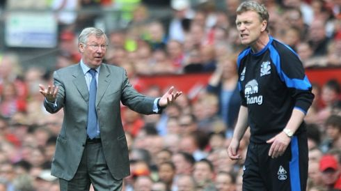 Everton manager David Moyes (right) shouts instructions to his team as Manchester United manager Alex Ferguson gestures to the officials regarding the amount of added time, on the touchline during a match in 2011. Photograph: Anna Gowthorpe/PA Wire.