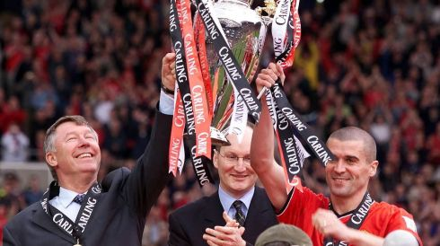 Alex Ferguson is applauded by his captain Roy Keane in 2001, as he lifts the FA Carling Premiership trophy. Photograph: Phil Noble/PA Wire.