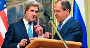 US secretary of state John Kerry (left) gestures as Russian foreign minister Sergei Lavrov tries to fix his translation equipment during a joint news conference after their meeting in Moscow yesterday. Russia and the United States have agreed to try to arrange an international conference this month on ending the civil war in Syria, and said both sides in the conflict should take part. Photograph: Mladen Antonov/Reuters