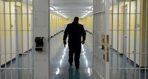 A Prison Officer in the commital unit where prisoners spend their first night in Dublin's Mountjoy Prison. Photograph: Cyril Byrne/The Irish Times.