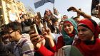Egyptians use their mobile phones to record celebrations in Cairo's Tahrir Square, the epicentre of the popular revolt that drove veteran leader Hosni Mubarak from power in 2011. Photograph: Mohammad Abed/AFP/Getty Image