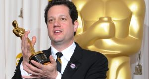 Michael Giacchino with the Oscar he won for Up. Photograph: Mark Ralston/AFP/Getty Images
